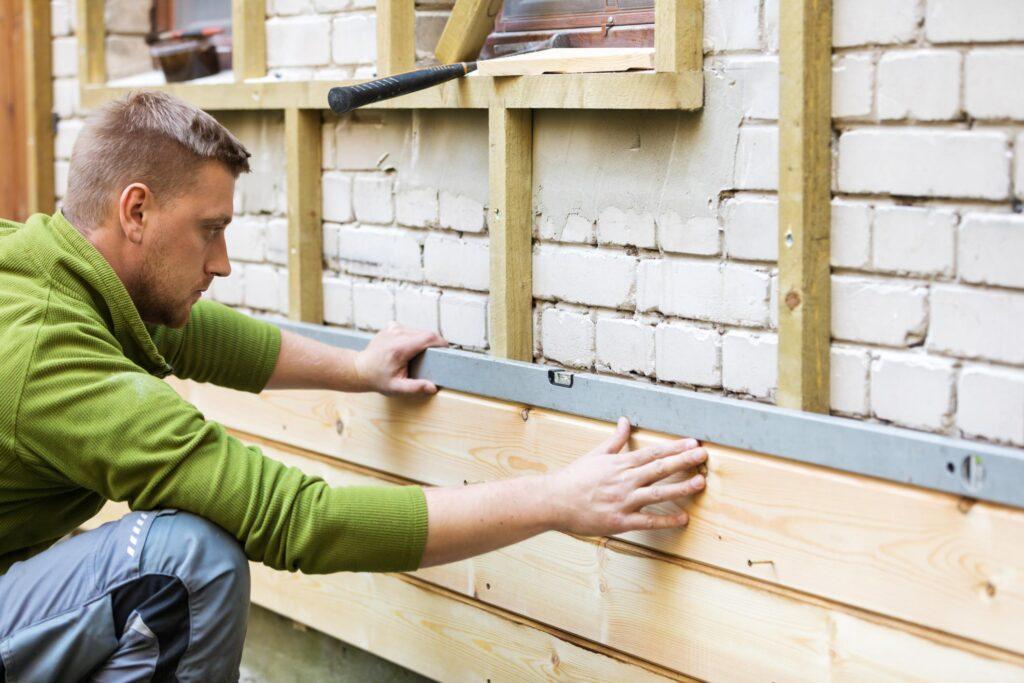 man installing wall sidings